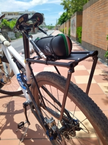 luggage carrier for suspension bike